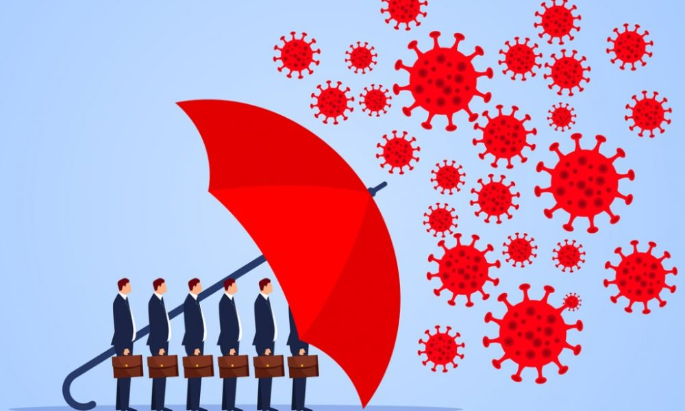 red umbrella protecting businessmen from virus bacteria